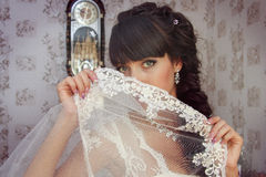Beautiful bride covers her face with veil Royalty Free Stock Images