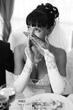 Beautiful bride crying. Black and white portrait of beautiful bride. Crying. Siting at the table Stock Photo