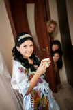 Beautiful bride with a cup of tea prepares for a wedding ceremony Stock Photos