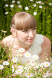 Beautiful bride in daisies Stock Photography