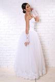 Beautiful bride with dark hair in elegant wedding dress with accessories Royalty Free Stock Photography