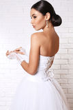 Beautiful bride with dark hair in elegant wedding dress with accessories Royalty Free Stock Photos