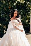 beautiful bride with dark hair in luxurious wedding dress in elegant villa royalty free stock image