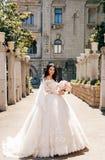 beautiful bride with dark hair in luxurious wedding dress in elegant villa stock images