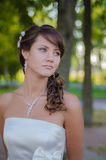 Beautiful bride is dreaming in her wedding day Stock Photos