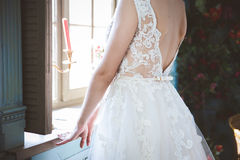 Beautiful  Bride is dressing the dress. Stock Image