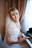 Beautiful Bride and electronic piano Stock Photography