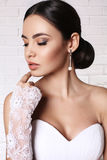 Beautiful bride with elegant hairstyle wearing wedding dress Royalty Free Stock Image