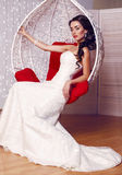 Beautiful bride in elegant wedding dress posing in studio Royalty Free Stock Photo