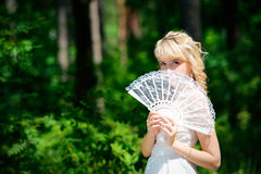 Beautiful bride with fan Stock Photography