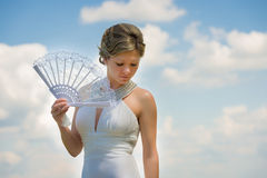 Beautiful bride with fan Stock Photos
