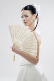 Beautiful bride with a fan Royalty Free Stock Images