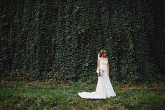 Beautiful bride in fashion wedding dress on natural background. Wedding day. A beautiful bride portrait royalty free stock image