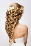 Beautiful bride with fashion wedding hairstyle. Royalty Free Stock Photography