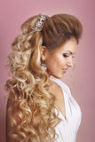 Beautiful bride with fashion wedding hairstyle - on pink background.Closeup portrait of young gorgeous bride. Wedding. Studio shot. Beautiful bride portrait Stock Photography