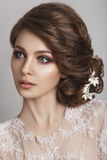 Beautiful bride with fashion wedding hairstyle - on white background. Closeup portrait of young gorgeous bride. Wedding. Studio shot. Beautiful bride portrait Stock Photos