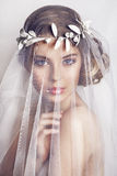 Beautiful bride with fashion wedding hairstyle - on white background. Closeup portrait of young gorgeous bride. Wedding. Studio shot.Beautiful bride portrait Royalty Free Stock Photos