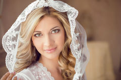 Beautiful bride with fashion wedding hairstyle in white veil. Cl Stock Image