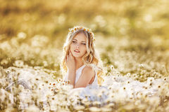 Beautiful bride in a field. Of daisies Royalty Free Stock Photo
