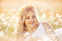 Beautiful bride in a field Royalty Free Stock Images