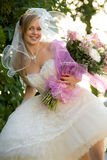 Beautiful bride with flowers. Beautiful young bride with flowers Royalty Free Stock Photo