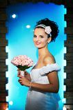 Beautiful bride with flowers on blue background Stock Image