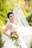 Beautiful bride with flowers Royalty Free Stock Images
