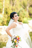 Beautiful bride with flowers Stock Images