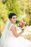 Beautiful bride with flowers Stock Photos