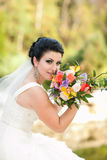 Beautiful bride with flowers Stock Image