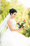 Beautiful bride with flowers Royalty Free Stock Photography