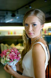 Beautiful bride with flowers in cafe Royalty Free Stock Images