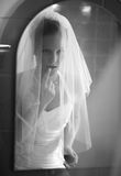 Beautiful bride  in front of a mirror Royalty Free Stock Photo