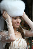 Beautiful bride in a fur Hat Stock Photography