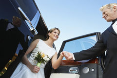 Beautiful Bride Getting Down From Car Royalty Free Stock Photography