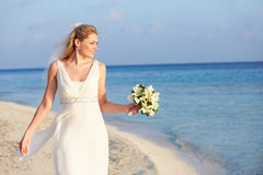 Beautiful Bride Getting Married In Beach Ceremony Stock Photo