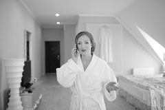 Beautiful bride  getting ready at hotel room. Bridal happy moments. Royalty Free Stock Images