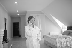 Beautiful bride  getting ready at hotel room. Bridal happy moments. Royalty Free Stock Photos