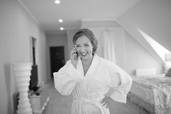 Beautiful bride  getting ready at hotel room. Bridal happy moments. Royalty Free Stock Image