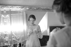 Beautiful bride  getting ready at hotel room. Bridal happy moments. Stock Photos