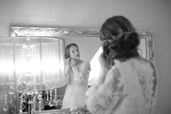 Beautiful bride  getting ready at hotel room. Bridal happy moments. Stock Photography
