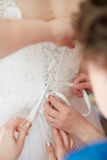 Beautiful bride is getting ready in the morning Royalty Free Stock Photo