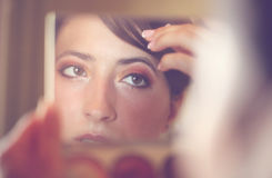 Beautiful bride getting ready for wedding Royalty Free Stock Photos