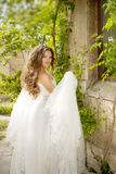Beautiful bride girl walking at wedding day, happy woman in blow Stock Photo