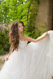 Beautiful bride girl walking at wedding day, happy woman in blow Stock Images