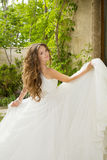 Beautiful bride girl walking at wedding day, happy woman in blow Royalty Free Stock Photos