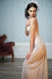 Beautiful Bride Glancing Over Shoulder Stock Images