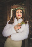 Beautiful bride with glass of champagne outdoors on winter evening Royalty Free Stock Images