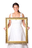 Beautiful bride with gold frame Stock Photography