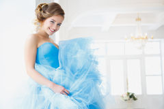 Beautiful bride in gorgeous blue dress Cinderella style Royalty Free Stock Photography
